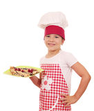 Little girl cook with sweet crepes on plate Royalty Free Stock Photography