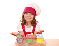 Little girl cook with sweet cupcakes Royalty Free Stock Photo