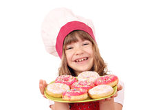 Little girl cook with sweet donuts Stock Image