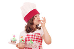 Little girl cook with sweet muffin Royalty Free Stock Photos