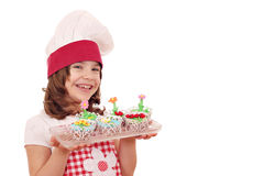 Little girl cook with sweet muffins Stock Photography