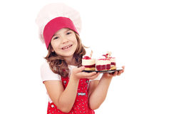 Little girl cook with sweet raspberry cake Royalty Free Stock Image