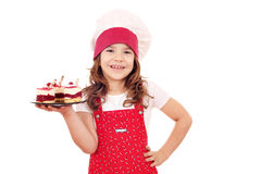 Little girl cook with sweet raspberry cake Royalty Free Stock Photos