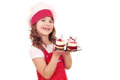 Little girl cook with sweet raspberry cake Stock Photography