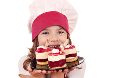 Little girl cook with sweet raspberry cake Royalty Free Stock Photo