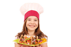Little girl cook with tacos fast food on plate Royalty Free Stock Images