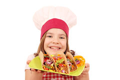 Little girl cook with tacos Stock Photography