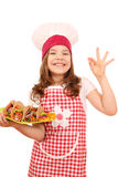 Little girl cook with tacos and ok hand sign Royalty Free Stock Image