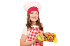 Little girl cook with tacos on plate Stock Image