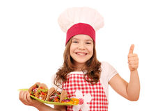 Little girl cook with tacos and thumb up Royalty Free Stock Photos