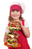 Little girl cook with tall sandwich Royalty Free Stock Photo