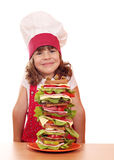 Little girl cook and tall sandwich Stock Photos