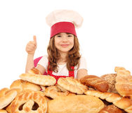 Little girl cook with thumb up and bread Royalty Free Stock Photo