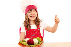 Little girl cook with thumb up and decorated salad Royalty Free Stock Photography