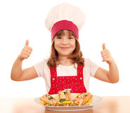 Little girl cook with thumb up and salmon seafood Stock Image