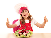 Little girl cook with thumbs up and decorated salad Stock Images