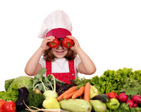 Little girl cook with tomato eyes Royalty Free Stock Images