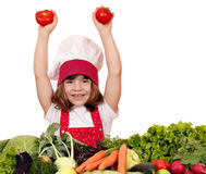 Little girl cook with tomatoes and vegetables Stock Image