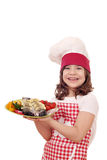 Little girl cook with trout fish on plate Stock Image