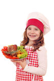 Little girl cook with turkey drumstick Royalty Free Stock Photography