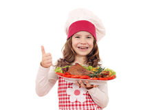 Little girl cook with turkey drumstick and thumb up Royalty Free Stock Images