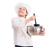 Little girl in cook uniform with pan and ladle Stock Photo