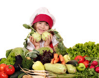 Little girl cook with vegetables Royalty Free Stock Photo