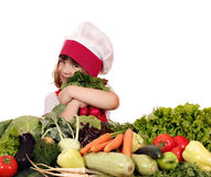 Little girl cook with vegetables Stock Image