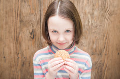 Little girl with cookies Royalty Free Stock Image