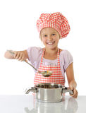 Little girl cooking Stock Images