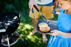 Little girl cooking burger Royalty Free Stock Photo