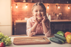 Little girl cooking Stock Photography