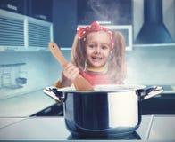 Little girl cooking Stock Photos