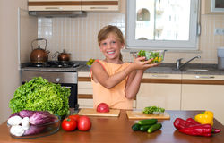 Little Girl Cooking. Healthy Food - Vegetable Salad. Diet. Dieting Concept. Healthy Lifestyle. Royalty Free Stock Photos