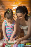 Little girl cooking with her mother Stock Photos