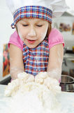 Little girl cooking in kitchen Stock Image