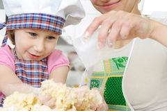 Little girl cooking in kitchen Stock Photography