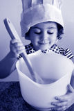 Little girl cooking in kitchen Royalty Free Stock Photography
