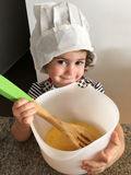 Little girl cooking in kitchen Royalty Free Stock Image