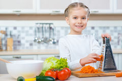 Little girl cooking in the kitchen Stock Photography