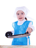 Little girl cooking pancakes Royalty Free Stock Photo