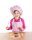 Little girl cooking pizza Stock Photos