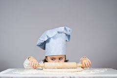 Little girl cooking pizza Royalty Free Stock Image