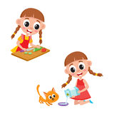 Little girl cooking salad and giving milk to cat Stock Photography