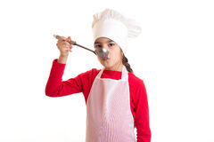 Little girl cooking Stock Image