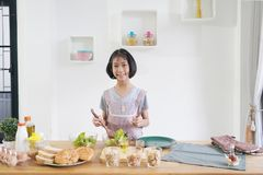 Little girl cooks in the kitchen stock image