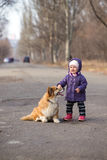 Little girl with corgi dog outdoors Royalty Free Stock Photography