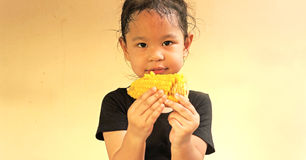 Little girl with corn Stock Photo
