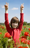 Little girl in the corn poppy Royalty Free Stock Photos