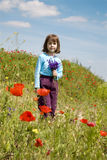 Little girl in the corn poppy Stock Images